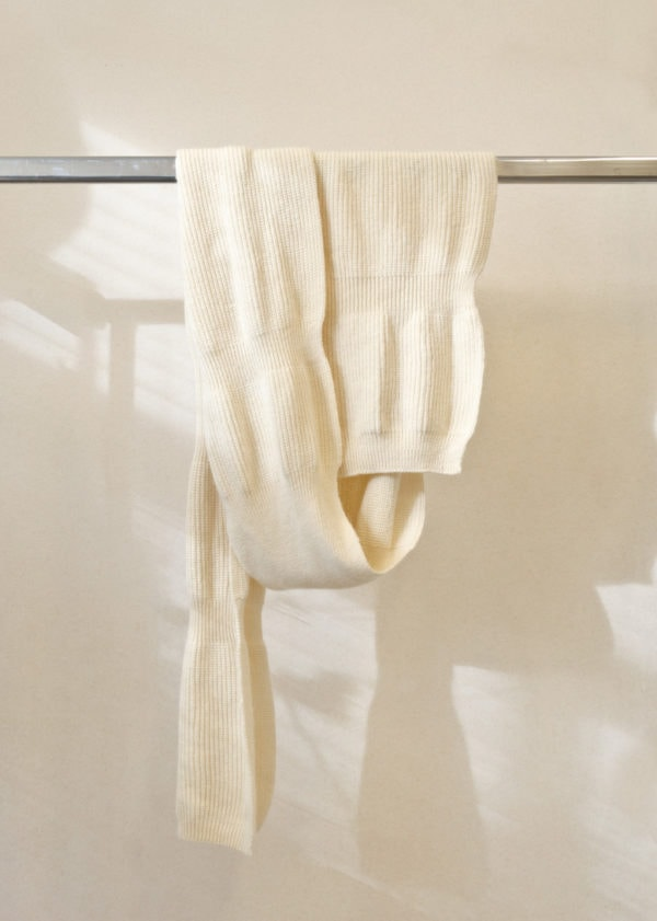 view of scarf BOUNCY in white,on a hanger