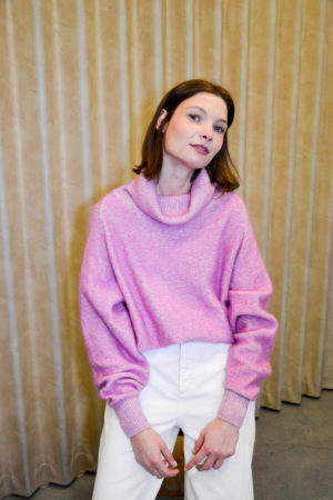 portrait of a young girl wearing a pink turtleneck sweater LIV