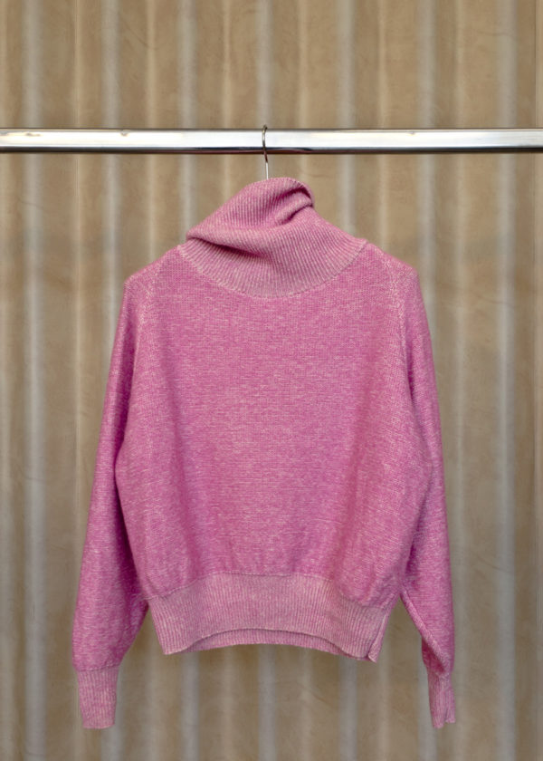 front view of turtleneck sweater LIV in rose on a hanger