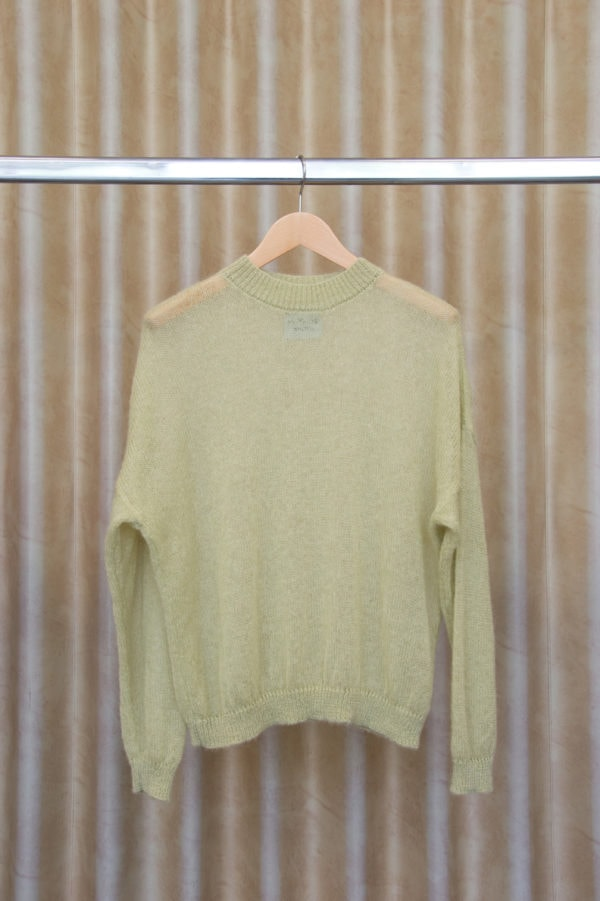 front view of LUCY sweater in chalk green on a hanger