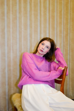 portrait of a young girl wearing sweater LUCY in hot pink
