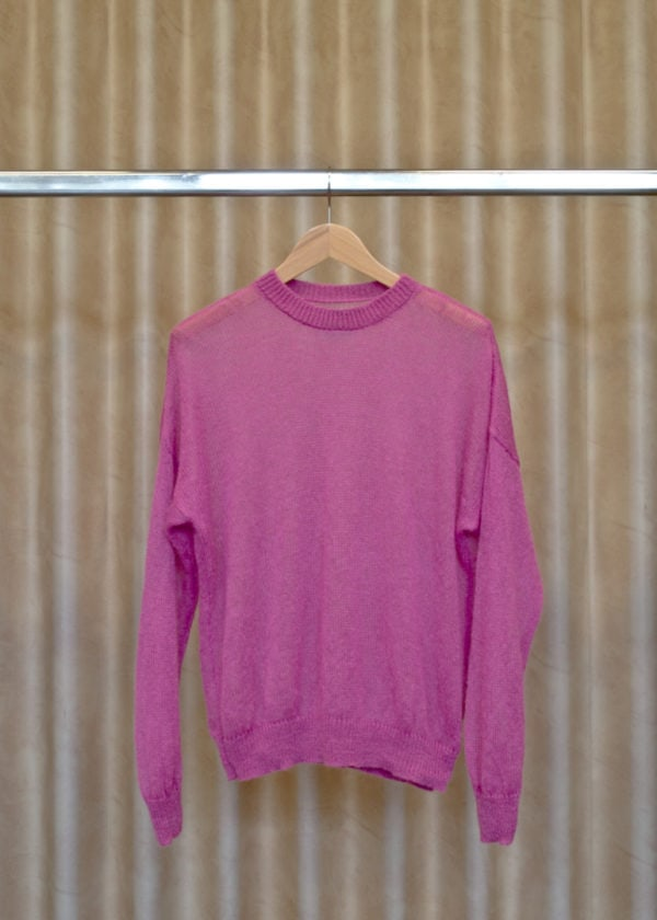 front view of a pink sweater on a hanger