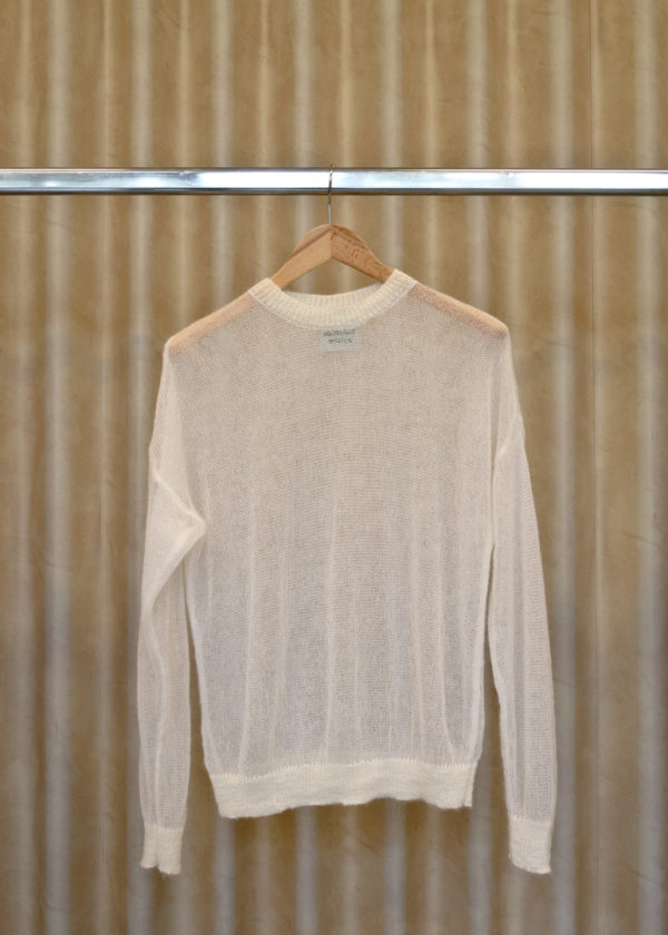 front view of LUCY sweater in white on a hanger