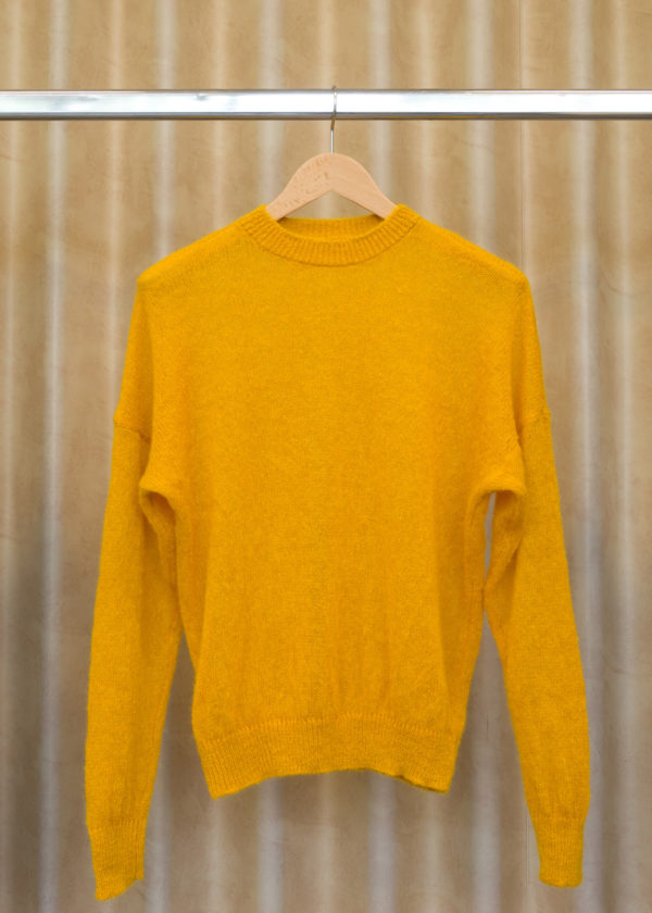 front view of LUCY sweater in sunny yellow on a hanger