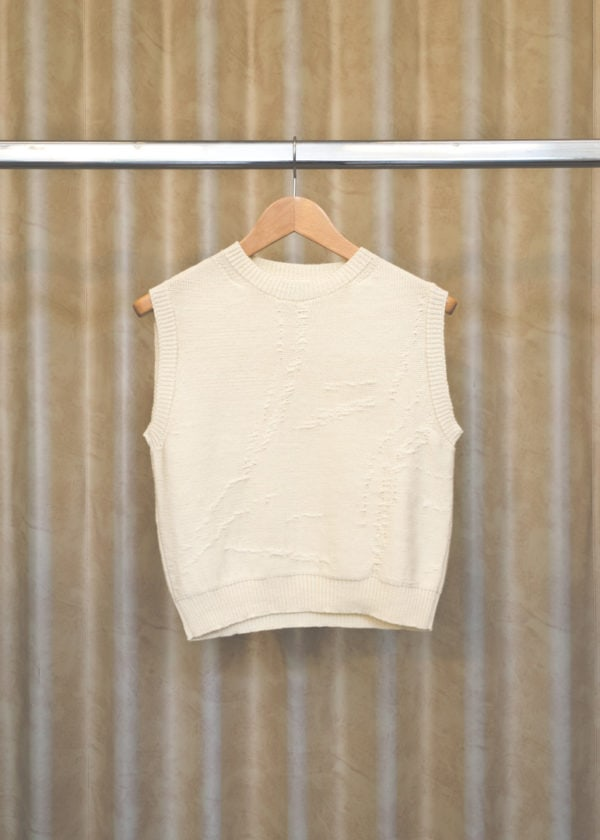 front view of pullover QILA in white on a hanger