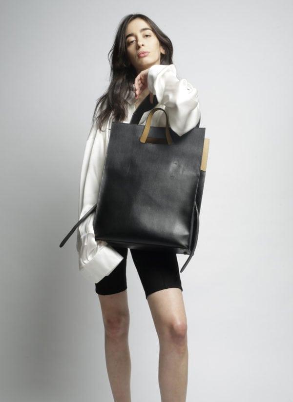 YNGR photo de profil avec femme tenant un sac