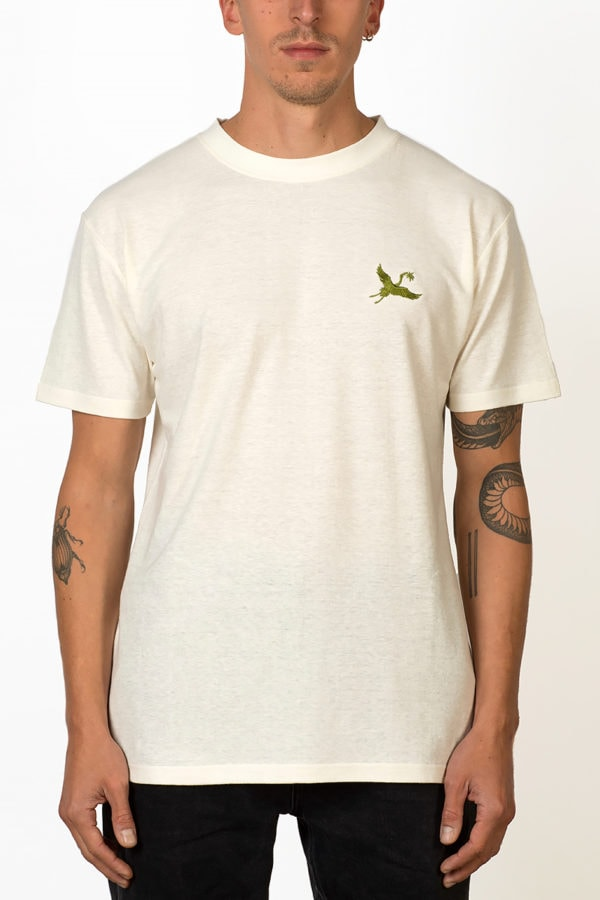 ornament hemp T-shirt in natural color with green crane embroidery on chest on male model