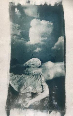 cyanotype of woman lying